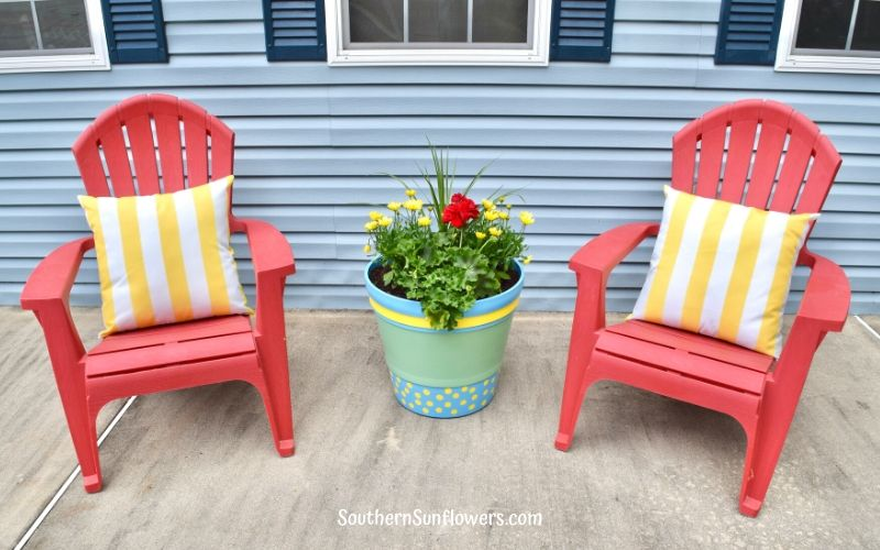 two chairs with the painted plastic flower pot