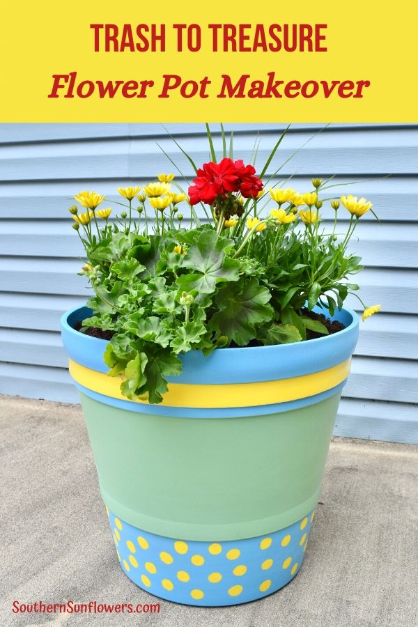completed painted plastic flower pot with flowers